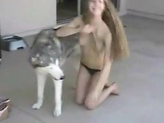 Naked young blond puss seduces a husky